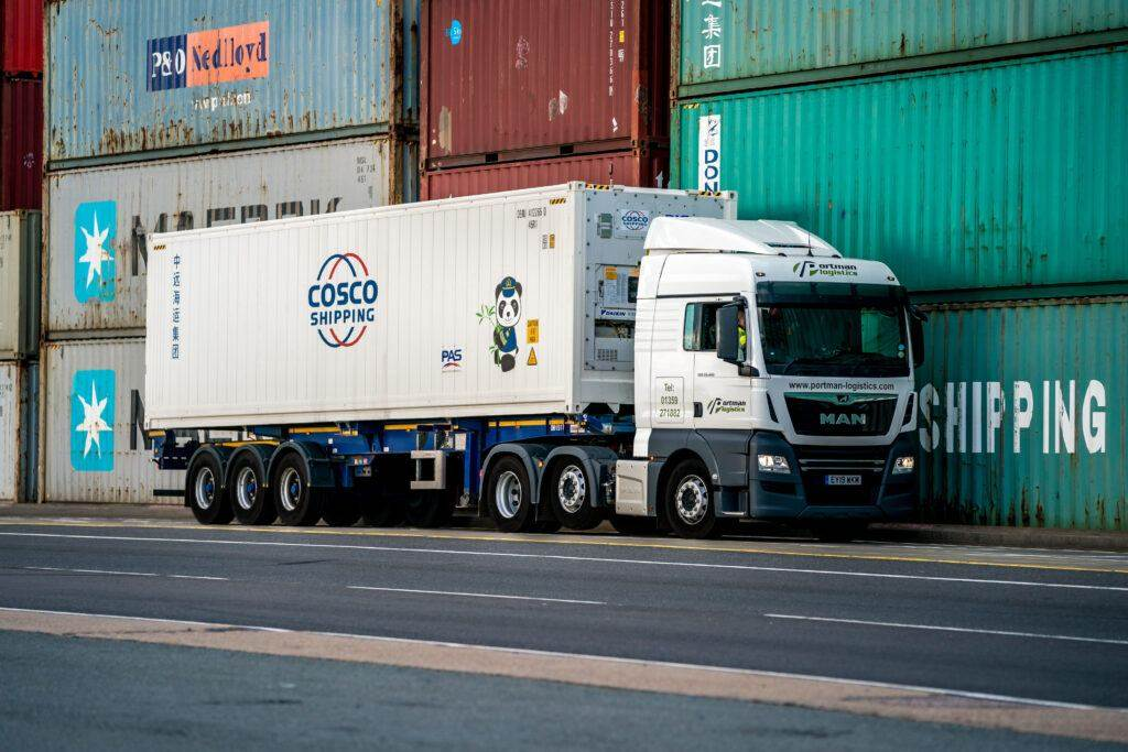 Portman MAN Truck alongside containers